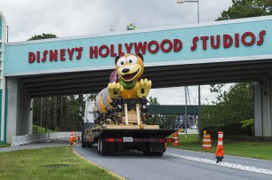 The first Slinky Dog Dash ride vehicle makes its way to Toy Story Land at Disney's Hollywood Studios in Lake Buena Vista, Fla. Slinky Dog Dash is a brand-new family coaster coming to the all-new Toy Story Land, opening summer 2018. Inspired by the playful dachshund spinoff of Slinky®, the classic American toy, Slinky® Dog Dash will send riders dipping, dodging and dashing around turns and drops that Andy has created to stretch Slinky® and his coils to the max. (Steven Diaz, photographer) (PRNewsfoto/Walt Disney World Resort)