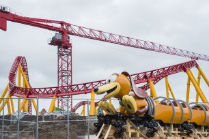 The first Slinky Dog Dash ride vehicle arrives on the site of Toy Story Land at Disney's Hollywood Studios in Lake Buena Vista, Fla. Slinky Dog Dash is a brand-new family coaster coming to the all-new Toy Story Land, opening summer 2018. Inspired by the playful dachshund spinoff of Slinky®, the classic American toy, Slinky® Dog Dash will send riders dipping, dodging and dashing around turns and drops that Andy has created to stretch Slinky® and his coils to the max. (Steven Diaz, photographer) (PRNewsfoto/Walt Disney World Resort)