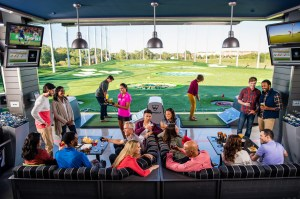 Guests playing Topgolf in Naperville, IL (PRNewsFoto/Topgolf)