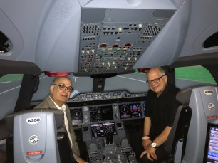 Miami-Dade Aviation Director González (left) and Florida International University President Mark B. Rosenberg, during a recent visit to the Airbus Training Center. (PRNewsfoto/Miami-Dade Aviation Department)