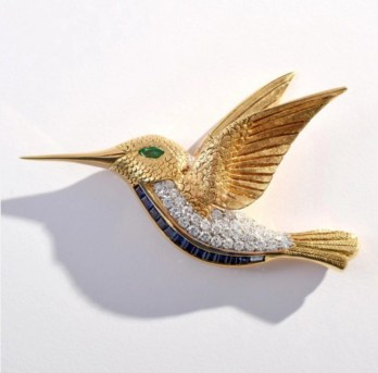 Fine jewelry will be available at price points to please most buyers, from this beautifully designed 18K gold, diamond, emerald and sapphire hummingbird brooch, estimate $4,000-$5,000, to an exquisite emerald and diamond ring that is expected to make $40,000-$60,000. Palm Beach Modern Auctions image (PRNewsfoto/Palm Beach Modern Auctions)