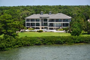 7922 South Holiday Drive Rear Exterior and Waterfront, Schemmel Property Group, Premier Sotheby's International Realty. PHOTO CREDIT: Coastal Home Photography and Concierge Auctions (PRNewsfoto/Premier Sotheby's International)
