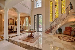 A stunning foyer with an eye-catching, grand marble staircase is just one of the features of the 'Foxborough Gem', one of Boca Raton's premier luxury homes which will be Auctioned off December 2. The nearly 12,000-square foot mansion, with marble/granite/onyx/mahogany floors imported from throughout Europe, has a 'wow' factor according to South Florida real estate experts. (PRNewsfoto/Jim Gall)