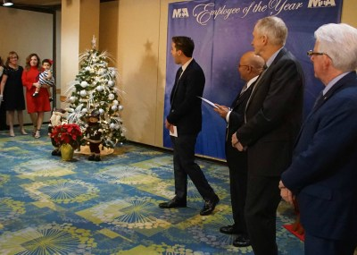 MDAD and GMVCB representatives look on as Consuegra is reunited with Rossi and Mia at MIA's Rewards and Recognition Year-End Gala on December 14. (PRNewsfoto/Miami International Airport)