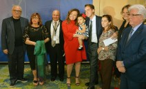MDAD's Joe Napoli (third from left) and GMVCB's Bill Talbert (far right) join Rossi and Consuegra's (center) families for a picture at MIA's Rewards and Recognition Year-End Gala on December 14. (PRNewsfoto/Miami International Airport)
