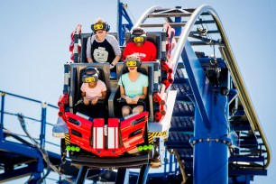 During The Great LEGO Race, riders wear optional virtual reality headsets to experience the point of view of a LEGO minifigure race car driver in a wild and wacky competition against a pirate, wizard, surfer, pharaoh and trendsetter. (PRNewsfoto/LEGOLAND Florida Resort)