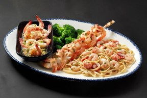 Red Lobster® guests are invited to explore exciting new flavors and preparations of shrimp during the Create Your Own Shrimp Trios event, like the NEW! Shrimp & Lobster Pasta, NEW! Crab-Topped Shrimp Skewer, and NEW! Parmesan Truffle Shrimp Scampi. (PRNewsfoto/Red Lobster Seafood Co.)