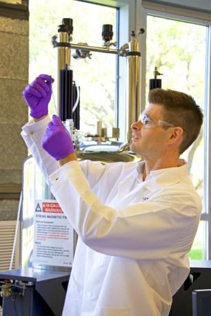 Dr. Sullivan preparing for Nuclear Magnetic Resonance (NMR) spectroscopy (PRNewsfoto/Intezyne Technologies, Inc.)