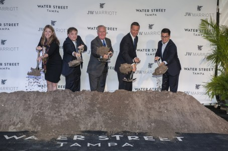 "Cissy Proctor, Executive Director, Florida Department of Economic Opportunity; Jeff Vinik, Partner, Strategic Property Partners, LLC; Robert ""Bob"" Buckhorn, Mayor of Tampa; Arne Sorenson, President and Chief Executive Officer, Marriott International, Inc.; and James Nozar, CEO, Strategic Property Partners, LLC; break ground on the city's first JW Marriott, to be located within the Water Street Tampa neighborhood. (PRNewsfoto/Strategic Property Partners)"