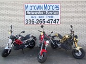 """At Midtown Motors we truly believe that """"It is not WHAT you ride, It's THAT you ride."""" However, no one ever said you can't ride in style! The Rocket combines the pleasures of a scooter with the hipness of a motorcycle, and will also get you about 100 miles per gallon. You do NOT NEED A MOTORCYCLE LICENSE to drive this machine. It is AUTOMATIC! Have a passenger? Put them on and go riding. (PRNewsfoto/Midtown Motors)"""