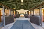 The property's covered barn includes 12 stalls, each measuring 12-ft by 12-ft, with rubber mats laid over sand-and-clay footing. The barn was built by Linehan Builders, and is positioned such that it receives a near-constant, natural breeze through its central corridor. Learn more at WellingtonLuxuryAuction.com. (PRNewsfoto/Platinum Luxury Auctions LLC)