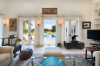 Shown here, the relaxing salon offers views and walkout access to the property's pool and spa. The 50-ft saltwater pool is surrounded by coral stone. Learn more at WellingtonLuxuryAuction.com. (PRNewsfoto/Platinum Luxury Auctions LLC)