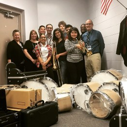 James Long, Principal, Gateway High School and students receive musical instruments. (PRNewsfoto/Live Music Tutor)