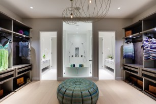 ITALKRAFT Closet at Missoni Baia Sales Center Featuring Finishes of Matte Lacquer and Suede. ITALKRAFT Bathrooms Featuring white soaking tub and marble counters (PRNewsfoto/ITALKRAFT)