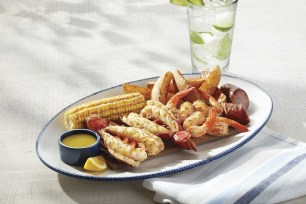 Red Lobster® is celebrating summer with the return of Lobster & Shrimp Summerfest, featuring four fresh, seasonally-inspired lobster and shrimp combinations, like the NEW! Cedar-Plank Seafood Bake. (PRNewsfoto/Red Lobster Seafood Co.)