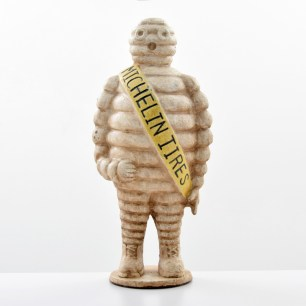 Cast-iron three-dimensional figure of Michelin Tires mascot 'Bibendum.' Sold for $2,080