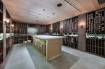 A true appreciation for wine is evidenced by the caliber of the custom-built wine room, located on the main living level adjacent to the kitchen. The climate-controlled room can store more than 5,000 bottles, and provides plenty of room for tastings. MiamiLuxuryAuction.com